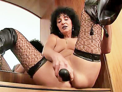 Slutty mommy fucks herself hard with huge dildo